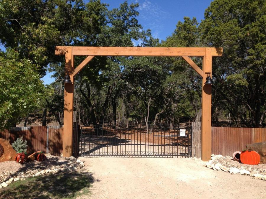 Redwoods Inc Waco - Cedar Entry Way with Iron Gate